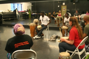 Moustapha giving instruction at drum class.