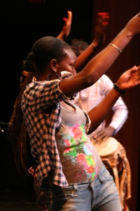 A student dances on stage.