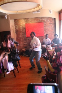 Marie-Claude, owner of Teranga Restaurant, dances to the rhytms.