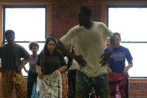 Moustapha leading students in the saber dance class.