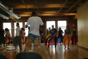 Moustapha Faye teaching dance to students at Suffolk University.