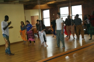 Moustapha teaching students in the saber dance class.