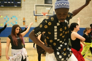Moustapha Faye preparing dance students for Celebration of Senegal.