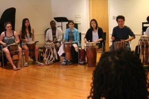 Students at the Cambridge School of Weston in sabar drum class.